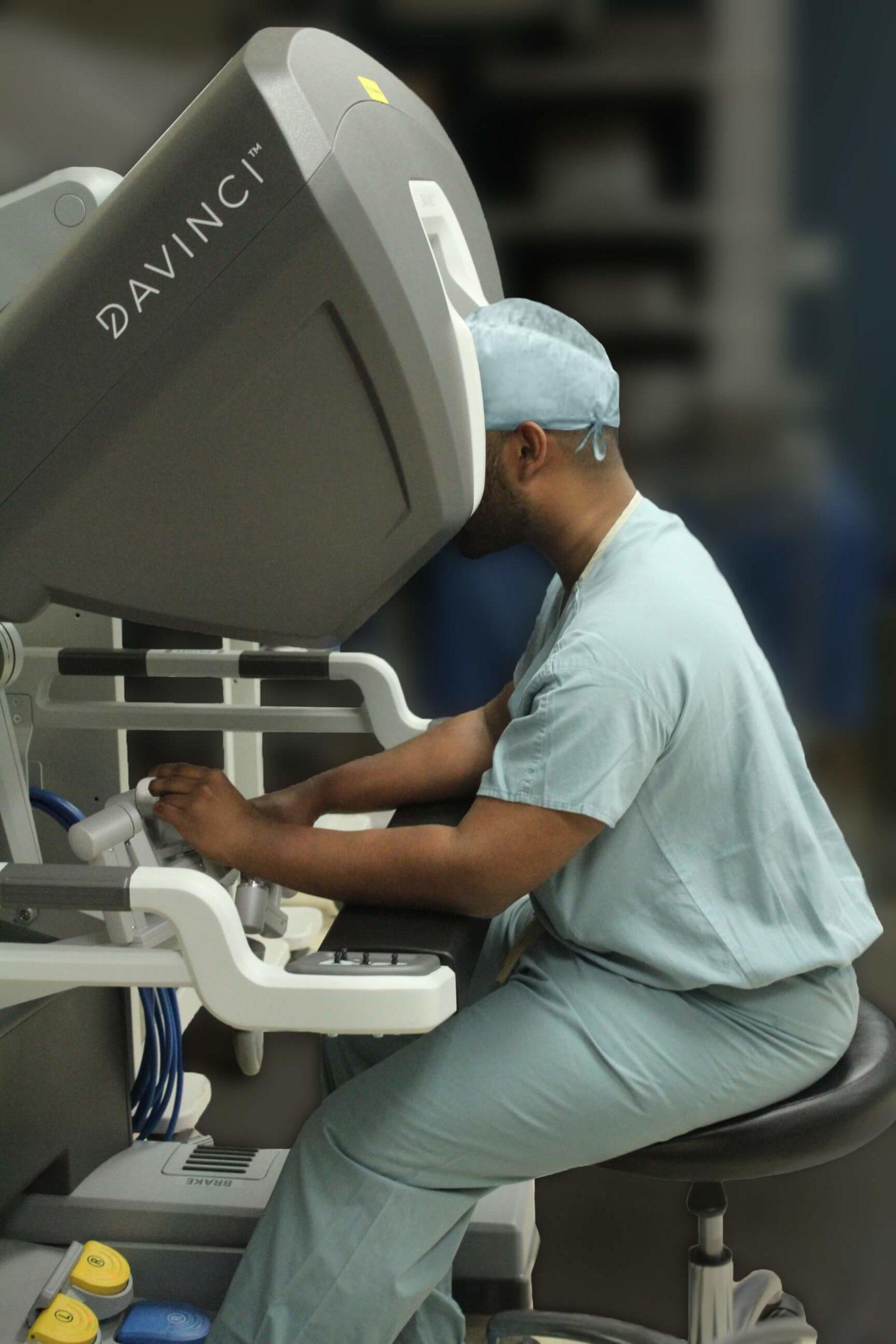 Dr Weranja doing robotic surgery